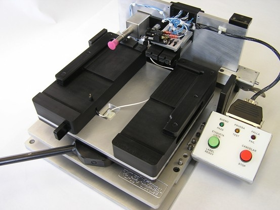 EEPROM verification fixture, including custom mechanical and electrical design and automation.