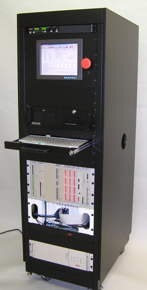 Custom designed NI PXI test console, including custom backplane, card cage, and custom test cards.
