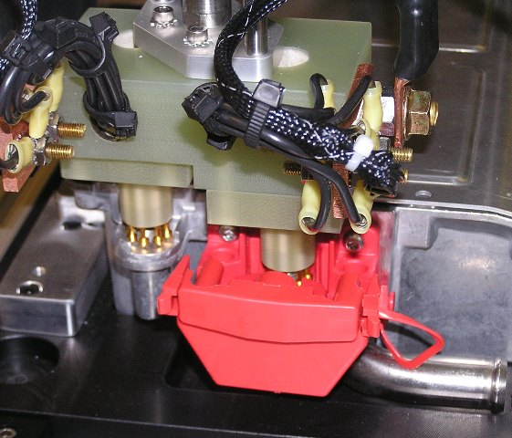Pneumatically actuated, custom-designed probe block for testing high-current engine control module for hybrid technology vehicle.